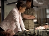 """TERRA NOVA:  Elisabeth (Shelley Conn, L) and Dr. Wallace (Rod Hallett, R) examine a group of fallen soldiers in the """"Instinct"""" episode of TERRA NOVA  airing Monday, Oct. 3 (8:00-9:00 PM ET/PT) on FOX.  ©2011 Fox Broadcasting Co.  Cr: Brook Rushton/FOX"""